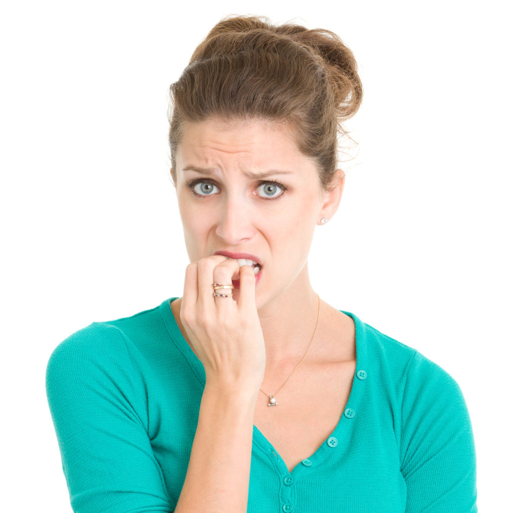 Nervous Young Woman Biting Nails.