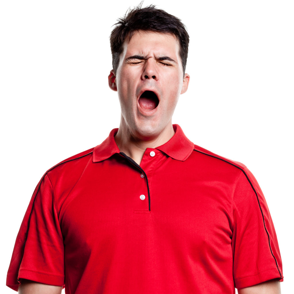 Man with red shirt and dark hair yawning.