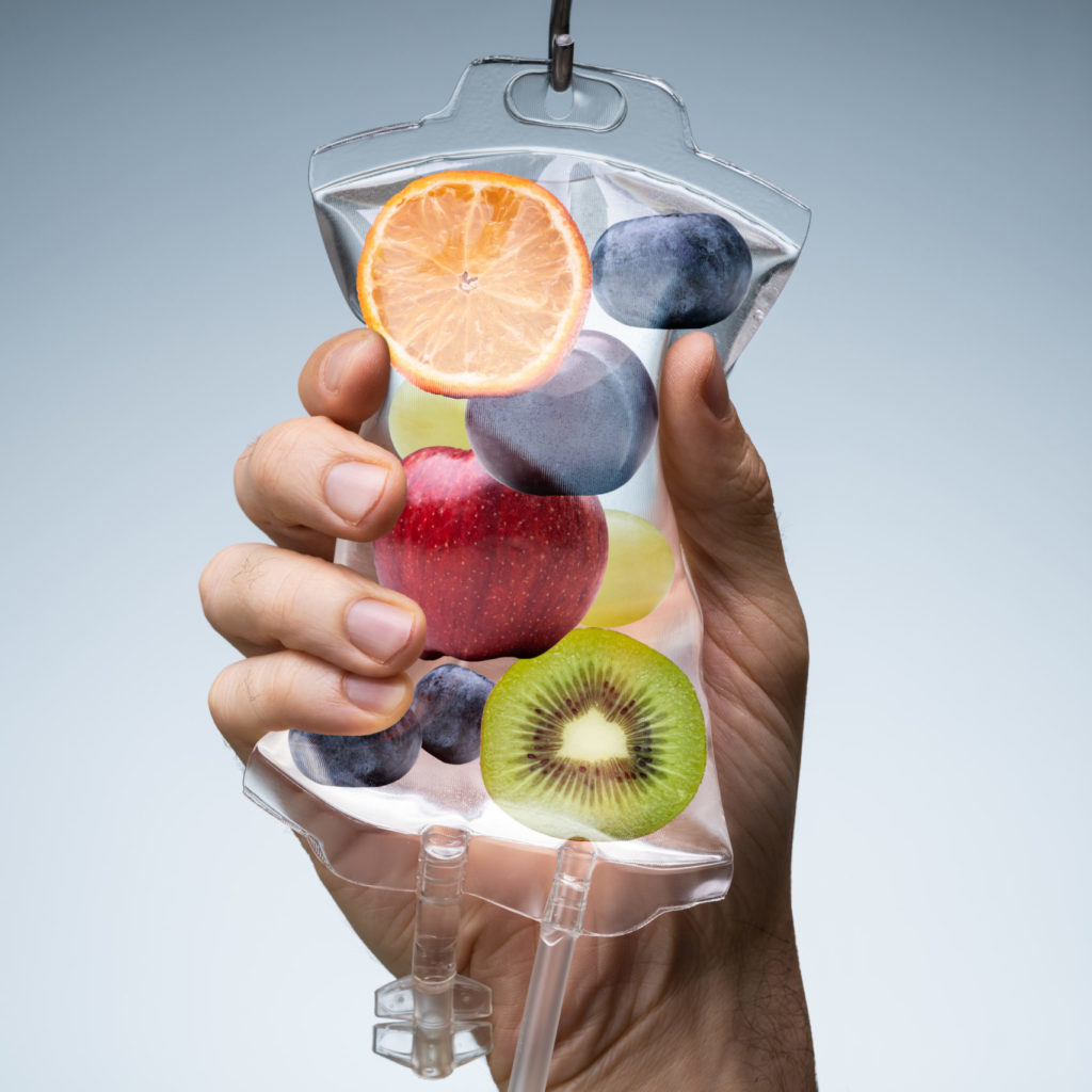 hand holding saline bag with fruit