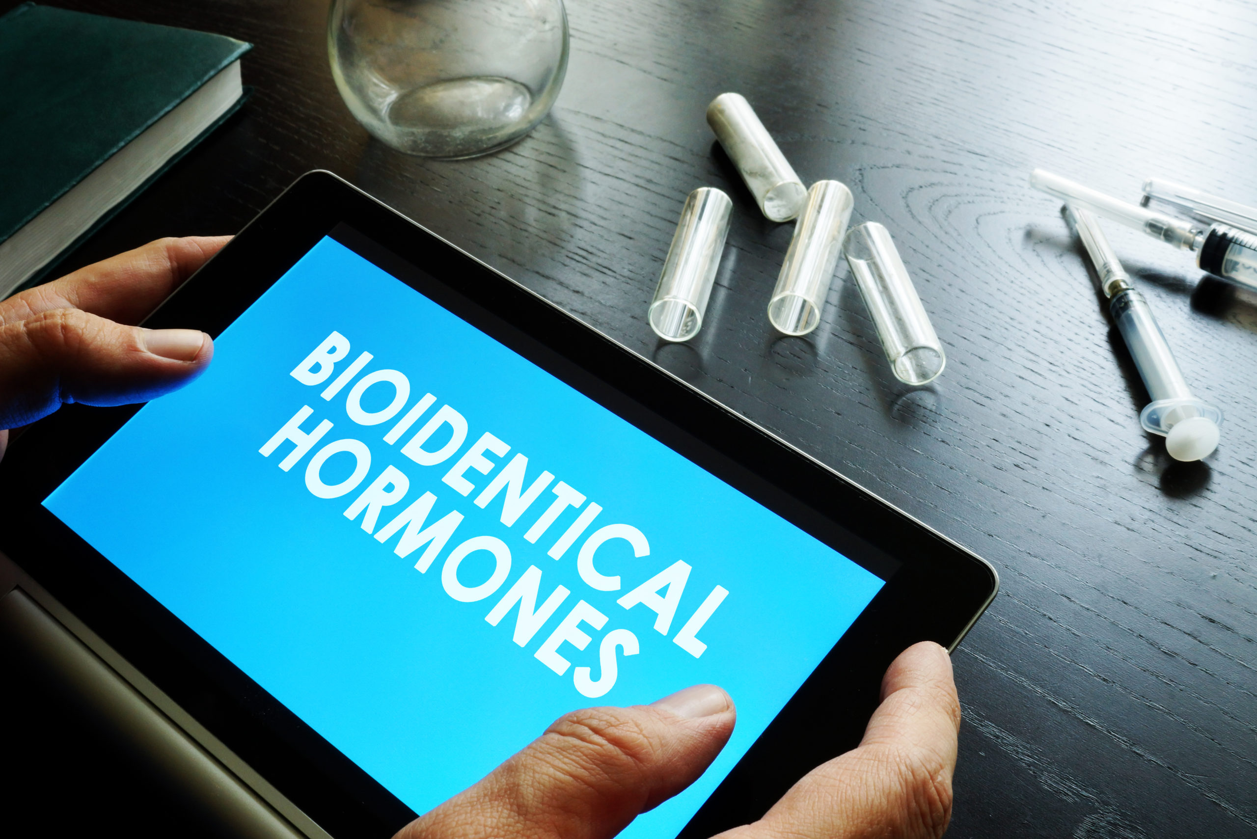doctor with tablet about biodentical hormones