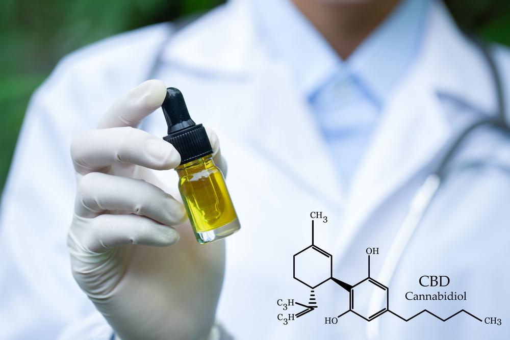 Clinician holding CBD oil bottle